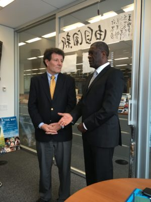 Nicholas Kristof of The New York Times (left) and Dr. Denis Mukwege
