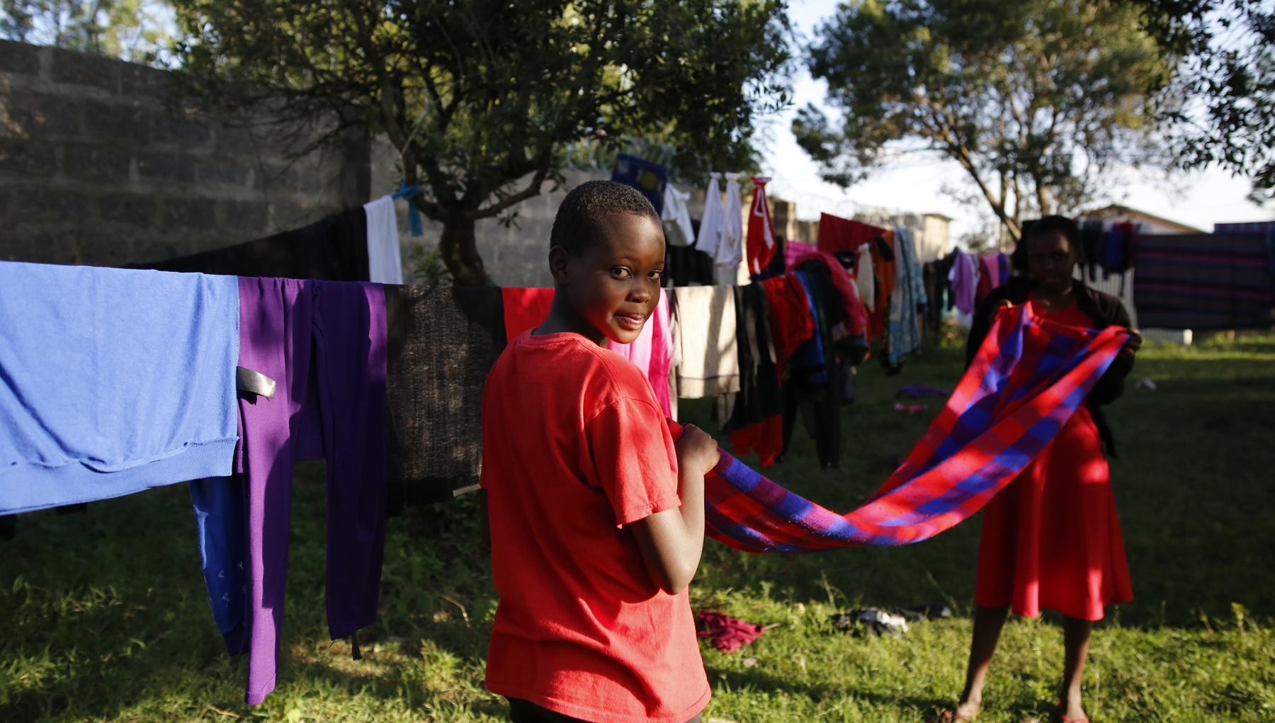Hanging-up-a-blanket-to-dry